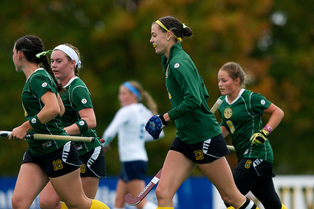 Catamounts midfielder Sally Snickenberger (16), Catamounts forward Colleen Slaughter (9),Catamounts midfielder Alana Izzo (13), and Catamounts forward Taylor Silvestro (6) celebrate a goal during the women's field hockey game between the Maine Black Bears and the Vermont Catamounts at Moulton/Winder Field on Saturday afternoon September 29, 2012 in Burlington, Vermont.