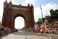 Anton Kosmac of Slovenia and Florian Pruller of Austria compete in the Mens Marathon during day six of the 20th European Athletics Championships at the roads of city Barcelona on August 1, 2010 in Barcelona, Spain. (Photo by Vid Ponikvar / Sportida)
