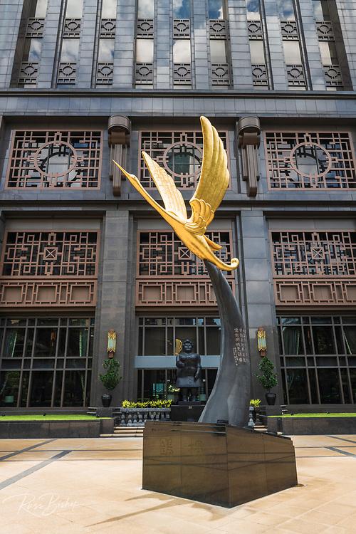Golden crane statue at the entrance to Parkview Square, Singapore, Republic of Singapore