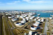 Nederland, Zuid-Holland, Rotterdam, 18-02-2015. Europoort, tanker terminal behorende bij raffinaderij van Kuwait Petroleum Europoort (KPE). Gezien naar de Nieuwe Waterweg met Maeslantkering aan de horizon. 5e Petroleumhaven.<br /> Kuwait (Q8) Petroleum refinery.<br /> luchtfoto (toeslag op standard tarieven);<br /> aerial photo (additional fee required);<br /> copyright foto/photo Siebe Swart