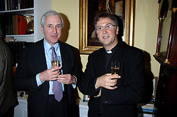 Left to right, HUGO VICKERS and FATHER MICHAEL SEED at a party to celebrate the 21st birthday of one of their horses Leopold, held at 35 Sloane Gardens, London W1 on 10th September 2007.<br />