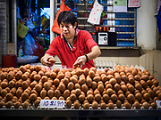09 JULY 2017 - SINGAPORE: An egg seller in the Tiong Bahru market, in the midst of the Tiong Bahru Housing estate, was the first indoor market in Singapore and is considered one of the best markets in Singapore. It was built in 1955 in an effort to organize vendors and get them off the neighborhood streets. Tiong Bahru neighborhood is now one of the most popular neighborhoods in Singapore for both expats and Singaporeans.    PHOTO BY JACK KURTZ