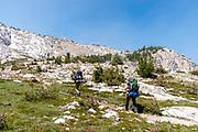 Backpackers take the John Muir Trail in stride, near Squaw Lake, John Muir Wilderness, Sierra National Forest, Sierra Nevada Mountains, California, USA.