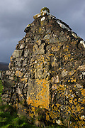 Old tombstone wall in Pennygowan Cemetery (Caol Fhaoileann), Salen Isle of Mull, Scotland. This ruined chapel, which served the N portion of the parish of Torosay, is probably of early 13th century date. No medieval references to it have been identified, and its dedication is unknown. The records of the Synod of Argyll in the middle of the 17th century show some uncertainty as to the status of the charge; it is referred to both as a 'Chappell' and as a 'paroach'. The building may already have been derelict at this period, although the earliest evidence of its condition dates from 1787 when it was shown as 'an old kirk' on a map of Torosay parish. Salen (Scottish Gaelic: An t-Sàilean) is a settlement on the Isle of Mull, Scotland. It is on the east coast of the island, on the Sound of Mull, approximately halfway between Craignure and Tobermory. The full name of the settlement is 'Sàilean Dubh Chaluim Chille' (the black little bay of St Columba)...http://www.undiscoveredscotland.co.uk/mull/pennygown/index.html