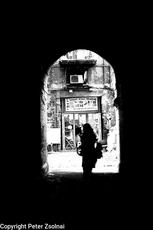 A pedestrian walks by a gate in Florance, Italy.