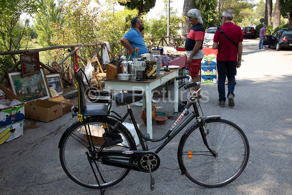 Flea market in the small town of Campello Sul Clitunno, Umbria, Italy. A flea market is a type of bazaar that rents or provides space to people who want to sell or barter merchandise. Usually seasonal. Used goods, cheap items, collectibles, and antiques are commonly sold.