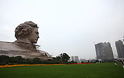 CHANGSHA, CHINA - NOVEMBER 27:  China Out - Finland Out<br /> <br /> Workers clean a statue of Mao Zedong born on December 26, 1893 on Juzi Island on November 27, 2013 in Changsha, China. This year marks the 120th Anniversary of Mao Zedong's Birth.<br /> ©Exclusivepix