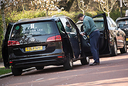 © Licensed to London News Pictures. 27/03/2020. London, UK. An Addison Lee driver cleaning out his mini cab near Regents Park, London during a lockdown over the Coronavirus spread. Prime Minister Boris Johnson has announced  that people should only leave their homes for essential work, groceries, medical necessity and exercise. Photo credit: Ben Cawthra/LNP