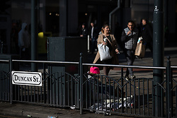 © Licensed to London News Pictures . 24/10/2018. Leeds , UK . A person sits on the pavement against railings on Duncan Street . At least six people sleeping rough have died in the Metropolitan Borough of the City of Leeds since March 2017 and West Yorkshire Police say they responded to 66 reported cases of people suffering the effects of Spice in July 2018 , a large increase on previous months . Photo credit : Joel Goodman/LNP