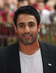 Red 2 UK film premiere.<br /> Ravi Bopara during the premiere of the sequel to 2010's graphic novel adaption, about a group of retired assassins. <br /> Empire Leicester Square<br /> London, United Kingdom<br /> Monday, 22nd July 2013<br /> Picture by i-Images