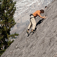 Chris Neve rock climbing on Rundle Rock near town of Banff in Alberta's Banff National Park, Canada.