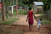 Two children walk down a dirt road in Guaimaca, Honduras.  Honduras is considered the third poorest country in the Western Hemisphere (Haiti, Nicaragua). With over 50% of the population living below the poverty line and 28% unemployed, Hondurans frequently turn to illegal immigration as a solution to their desperate situation. The Department of Homeland Security has noted an 95% increase in illegal immigrants coming from Honduras between 2000 and 2009, the largest increase of any country.