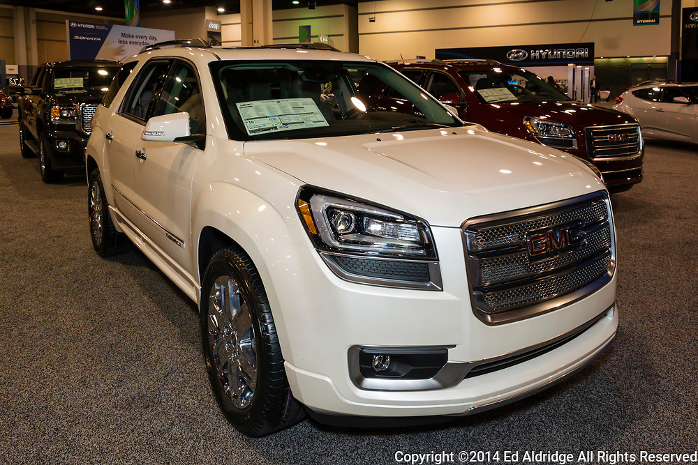 CHARLOTTE, NORTH CAROLINA - NOVEMBER 20, 2014: GMC Acadia on display during the 2014 Charlotte International Auto Show at the Charlotte Convention Center.