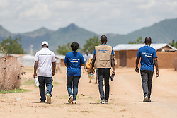 31 May 2019, Mokolo, Cameroon: Staff of the Lutheran World Federation's World Service programme walk through the Minawao camp for Nigerian refugees. The Minawao camp for Nigerian refugees, located in the Far North region of Cameroon, hosts some 58,000 refugees from North East Nigeria. The refugees are supported by the Lutheran World Federation, together with a range of partners.