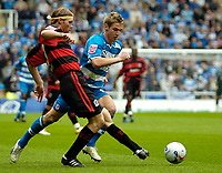 Photo: Ed Godden.<br /> Reading v Queens Park Rangers. Coca Cola Championship. 30/04/2006. QPR's Mauro Milanese (L) is met by Kevin Doyle (R).