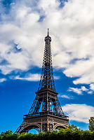 The Eiffel Tower from the River Seine, Paris, France.  The Eiffel Tower is the most famous landmark in Paris.