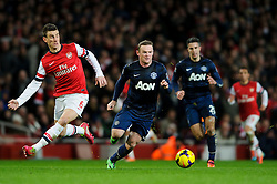 Man Utd Forward Wayne Rooney (ENG) is challenged by Arsenal Defender Laurent Koscielny (FRA) - Photo mandatory by-line: Rogan Thomson/JMP - 07966 386802 - 12/02/14 - SPORT - FOOTBALL - Emirates Stadium, London - Arsenal v Manchester United - Barclays Premier League.