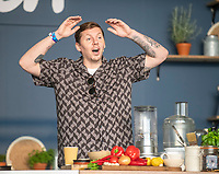 Gizzi Eeskin  teaching Professor Green  how to make a homemade Doner Kebab at the Big Feastival 2021 on Alex James' Cotswolds farm, Kingham oxfordshire