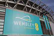 A banner for Wembley Stadium and the communications brand EE, on 6th November 2019, in Wembley, London, England. Wembley Stadium's mobile app and an interactive LED lighting system on the arch, which can respond to goals scored, crowd noise plus trialling contactless payments and ticketing with an aim to make over 50% of payments contactless. In 2018, the world's first live sporting event to be broadcast over 5G used remote production.
