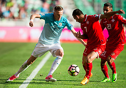 Josip Ilicic of Slovenia vs Clayton Failla of Malta and Stephen Pisani of Malta during football match between National teams of Slovenia and Malta in Round #6 of FIFA World Cup Russia 2018 qualifications in Group F, on June 10, 2017 in SRC Stozice, Ljubljana, Slovenia. Photo by Vid Ponikvar / Sportida