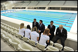 Britain's Prime Minister David Cameron (L) and Mayor of London Boris Johnson (R) together with Lord Sebastian Coe (2nd, L) and Jeremy Hunt Secretary of State for Culture, Olympics, Media and Sport visit the Olympic Aquatic Centre on January 9, 2012 in London, England. Cameron held a cabinet meeting at the 2012 Olympic Games site and highlighted the 'lasting legacy' the London 2012 Olympics will leave, as the London Olympics countdown enters its final 200 days, Monday January 9, 2012. Photo By Andrew Parsons/ i-Images