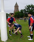 Photo: Richard Lane.<br /> New Zealand Maori training at Rugby School. Barclays Churchill Cup 2007. 21/05/2007. <br /> Maori's Keith Cameron (lt) and Hoani Tui coaches a pupil from the school.