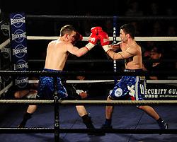 Lee Haskins blocks a hit - Photo mandatory by-line: Dougie Allward/JMP - Tel: Mobile: 07966 386802 27/04/2013 - SPORT - FOOTBALL - City Academy Sports Centre - Bristol - Lee Haskins V Martin Ward - British bantamweight title