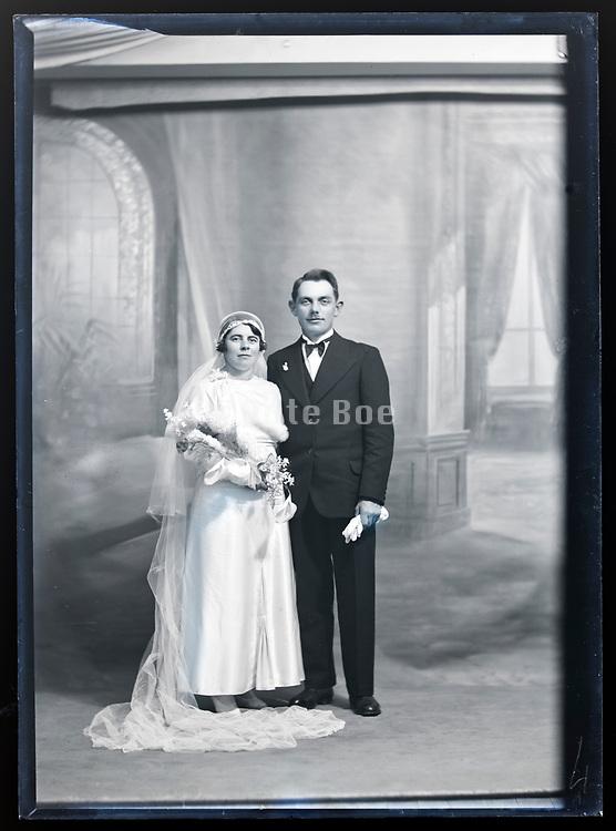 wedding portrait in studio with classic interior background France circa 1930s