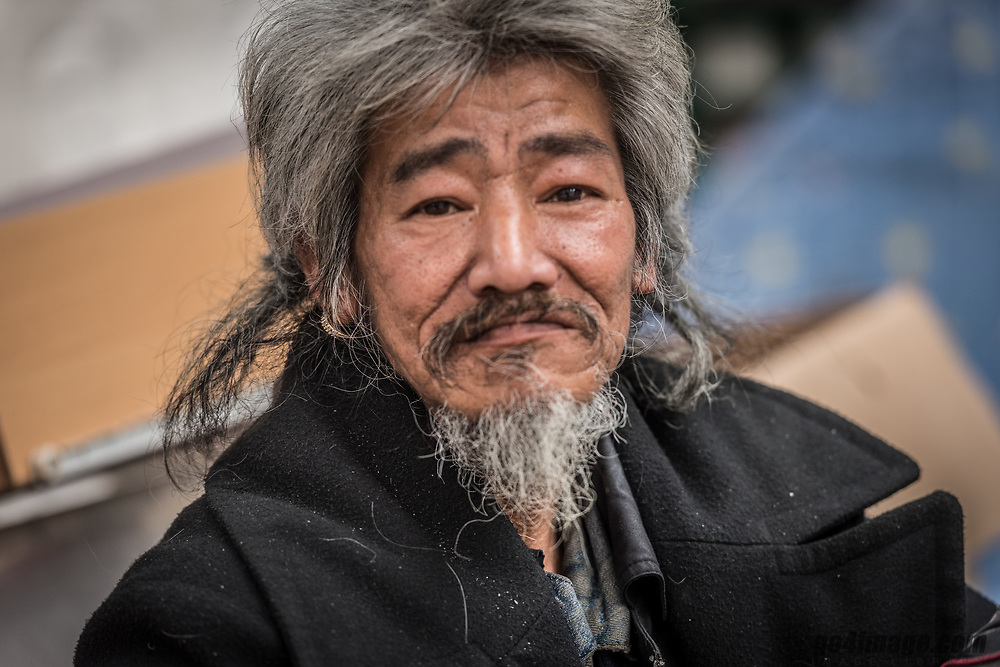 2018 January 26th, Hong Kong Mong KokMalau Kin<br /> Healty Monkey is his name. He lives on the street in Hong Kong near the Tin Hau temple in Mong Kok.