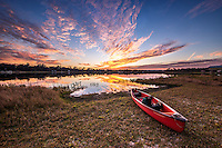 A kayak sits on the edge of McMeekin Lake in Hawthorne, FL ready for adventure.