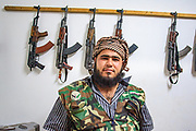 Kalashnikov assault rifles hang on the wall as Free Syrian Army (FSA) member pose for a picture at the FSA facilities in Marea on Monday, May 28, 2012. (Photo by Vudi Xhymshiti)