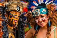 Street performers wearing Mayan costumes, La Quinta Avenida (5th Avenue), a pedestrian shopping street in Playa del Carmen, Riviera Maya, Quintana Roo, Mexico.