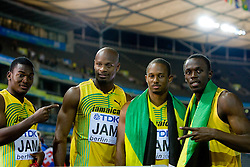 Steve Mullings, Asafa Powell, Michael Frater and Usain Bolt   of Jamaica celebrate winning the gold medal in the mens 4x100 Metres Relay Final with mascot Berlino during day eight of the 12th IAAF World Athletics Championships at the Olympic Stadium on August 22, 2009 in Berlin, Germany. (Photo by Vid Ponikvar / Sportida)