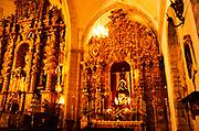 Elaborately decorated gilt altar inside the cathedral church of Santa Maria La Mayor, Ronda, Andalucia, Spain
