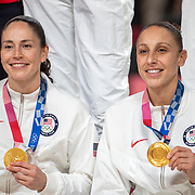 TOKYO, JAPAN August 8:  Five-time Olympic gold medalists Diana Taurasi, (right) and Sue Bird of the United States with their gold medals after the team victory during the Japan V USA basketball final for women at the Saitama Super Arena during the Tokyo 2020 Summer Olympic Games on August 8, 2021 in Tokyo, Japan. (Photo by Tim Clayton/Corbis via Getty Images)