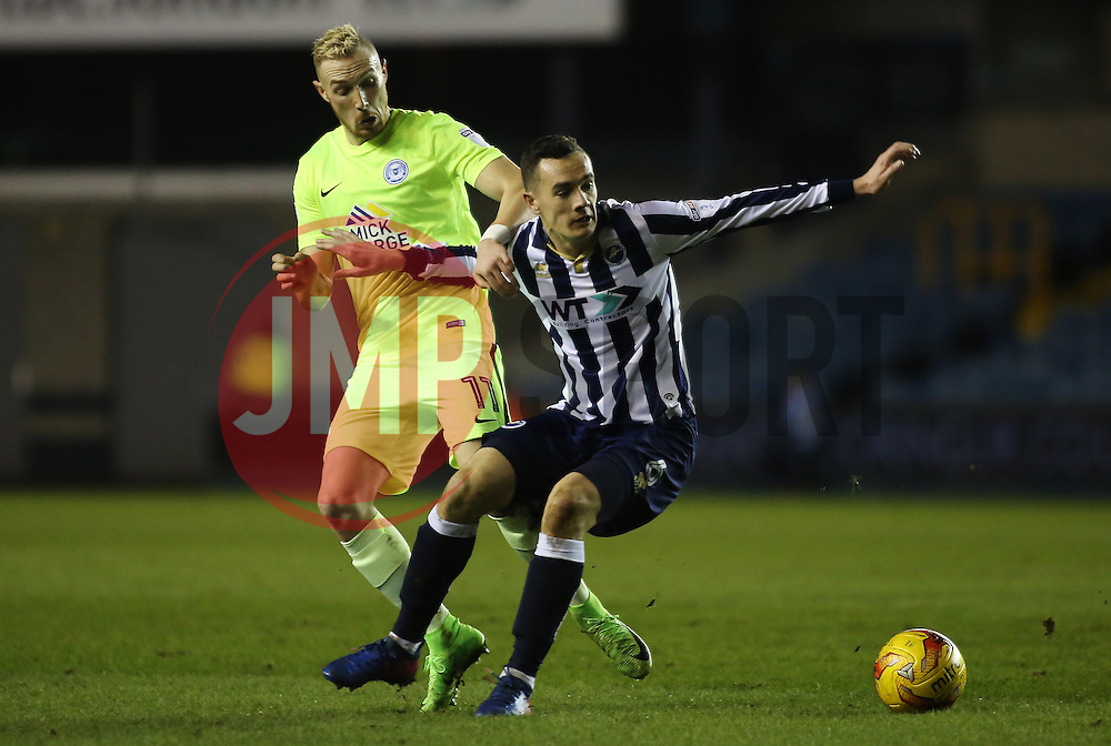 Marcus Maddison of Peterborough United in action with Shaun Williams of Millwall - Mandatory by-line: Joe Dent/JMP - 28/02/2017 - FOOTBALL - The Den - London, England - Millwall v Peterborough United - Sky Bet League One