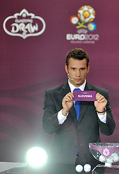 ANDRIY SCHEVCHENKO (UKRAINE) SHOWS THE TICKET OF SLOVENIA DURING THE UEFA EURO 2012 QUALIFYING DRAW IN PALACE SCIENCE AND CULTURE IN WARSAW, POLAND..THE 2012 EUROPEAN SOCCER CHAMPIONSHIP WILL BE HOSTED BY POLAND AND UKRAINE...WARSAW, POLAND , FEBRUARY 07, 2010.( PHOTO BY ADAM NURKIEWICZ / MEDIASPORT / SPORTIDA.COM ).