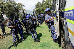 PRETORIA, Oct. 20, 2016 (Xinhua) -- Police officials stand in front of the fence outside the Union Buildings, the official seat of the?South African government, in Pretoria, on Oct. 20, 2016. The latest wave of student protests has continued for weeks since universities were given the green light by the government last month to raise tuition fees, provided that it does not exceed eight percent.?Students are demanding zero-percent fee increase and pressing the ruling African National Congress to live up to its promise to provide free education by 2016. (Xinhua/Zhai Jianlan) (Credit Image: © Zhai Jianlan/Xinhua via ZUMA Wire)