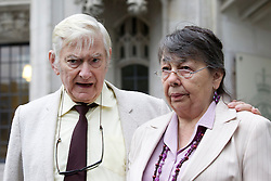 © Licensed to London News Pictures. 27/11/2013. London, UK. Owners of the Chymorvah Hotel in Marazion, Cornwall, Hazelmary and Peter Bull, are seen outside the Supreme Court to after hearing judgement on their case in London today (27/11/2013). The couple found out today that they failed in their bid to have a previous judgement, ordering them to pay damages to a gay couple who were told that they could not share a double bed at the bed and breakfast, overturned.