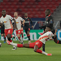 Nordi Mukiele (front) of RB Leipzig reaches for the ball during the UEFA Champions League Round of 16 First Leg Football match between RB Leipzig and Liverpool FC in Budapest, Hungary on Feb. 16, 2021. ATTILA VOLGYI