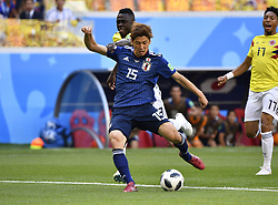 June 19, 2018 - Saransk, Russia - Yuya Osako (front) of Japan shoots during a Group H match between Colombia and Japan at the 2018 FIFA World Cup in Saransk, Russia, June 19, 2018. (Credit Image: © He Canling/Xinhua via ZUMA Wire)