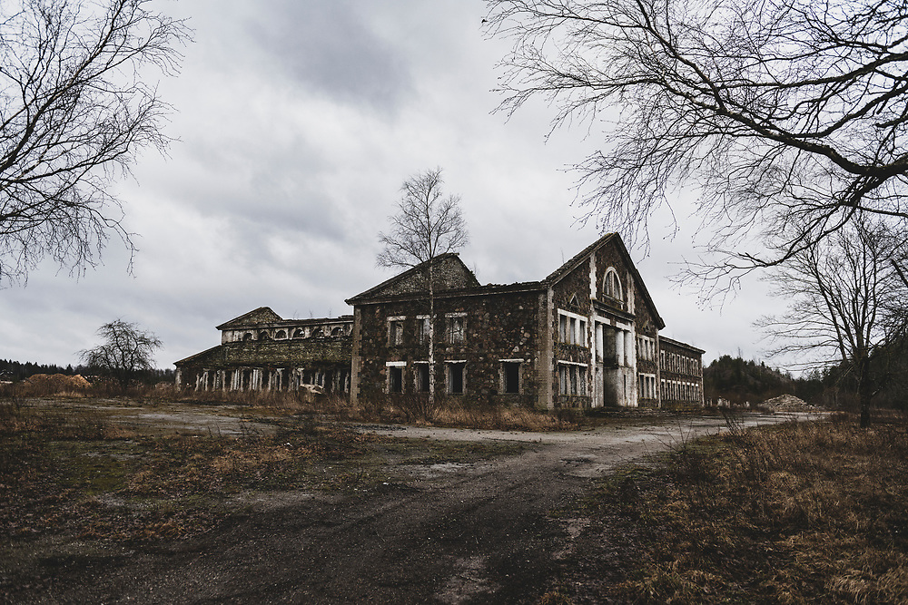Sompa, Estonia - February 22, 2020: Built in the late 1940s by German prisoners of war and now in disrepair, this building was part of the shale oil mining operation in Sampa from 1948-1999.