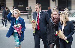 © Licensed to London News Pictures.23/03/2017.London, UK. Toby Perkins MP (2L) carries flower to Westminster Bridge with other colleagues. A lone terrorist killed 4 people and injured several more, in an attack using a car and a knife at Parliament and on Westminster Bridge yesterday. The attacker managed to gain entry to the grounds of the Houses of Parliament, killing one police officer.Photo credit: Peter Macdiarmid/LNP