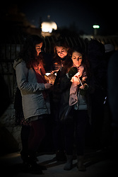 18 April 2019, Jerusalem: A group of pilgrims share a moment of prayer, as on Maundy Thursday (Western tradition), the Church of Gethsemane filled to the brim with Christians from Jerusalem and all over the world participating in the Easter celebrations, who then lit candles, marching through the valley below, and up the hillside to share a moment of prayer.