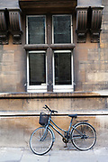 A students bicycle parked on a Cambridge street, Cambridge University, Cambridge, United Kingdom. Cambridge has a very high proportion of trips by bike because it is a university city.