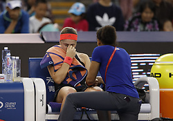 BEIJING, Oct. 2, 2018  Jelena Ostapenko(L) of Latvia receives medical treatment during the women's singles second round match against Wang Qiang of China at China Open tennis tournament in Beijing, China, Oct. 2, 2018. Jelena Ostapenko lost 0-2. (Credit Image: © Jia Haocheng/Xinhua via ZUMA Wire)