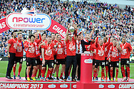 Cardiff city players celebrate as capt Mark Hudson lifts the championship trophy. NPower championship, Cardiff city v Bolton Wanderers at the Cardiff city Stadium in Cardiff, South Wales on Saturday 27th April 2013. pic by Andrew Orchard,  Andrew Orchard sports photography,