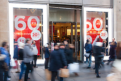"London, December 20th 2014. Tens of thousands of shoppers descend on central London to scoop up pre-Christmas bargains as retailers offer discount incentives on ""Panic Saturday"". PICTURED: High street stores are offering up to 60% discounts to lure shoppers in."