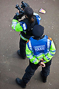 Police cocument the TUC March for the Alternative 26 March 2011 event. using still and video cameras. Forward Intelligence Teams (FITs) are two or more police officers who are deployed by UK police forces to gather intelligence on the ground and in some circumstances, to disrupt activists and deter anti-social behaviour. They use cameras, camcorders and audio recorders to conduct overt surveillance of the public.