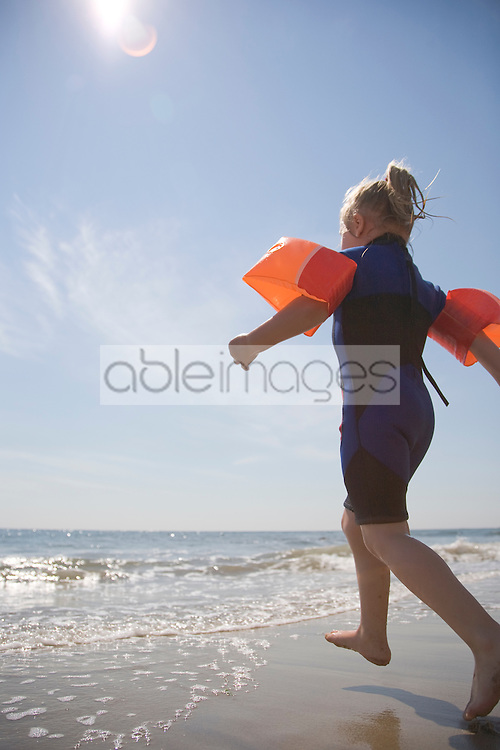 Young girl going swimming wiht arm bands